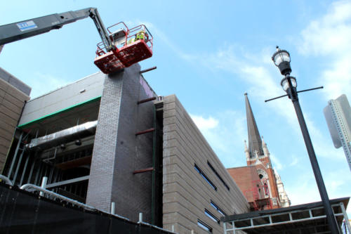Beams installed to place large cross facing Broadway